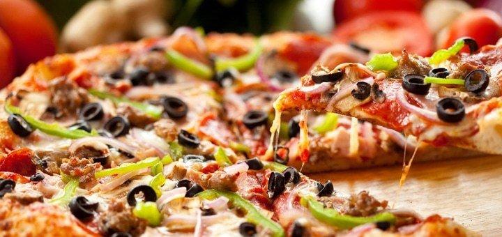Скидка до 60% на все меню службы доставки «Пицца Подол»